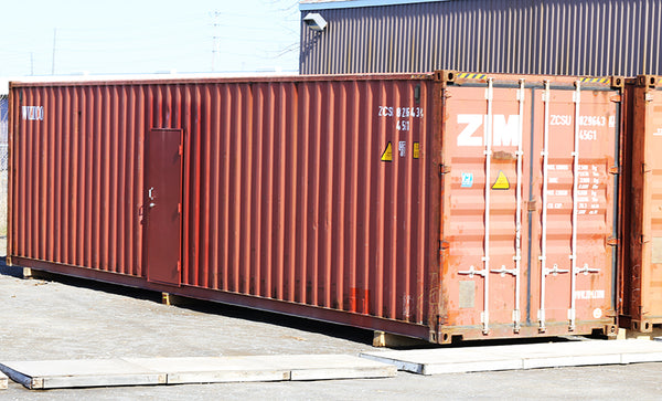 shipping container modified with additional man door