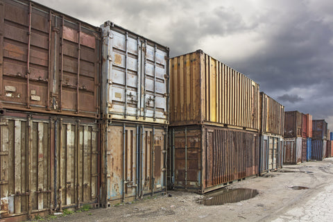 Rusty shipping containers in a yard