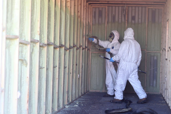 Spray foaming a shipping container