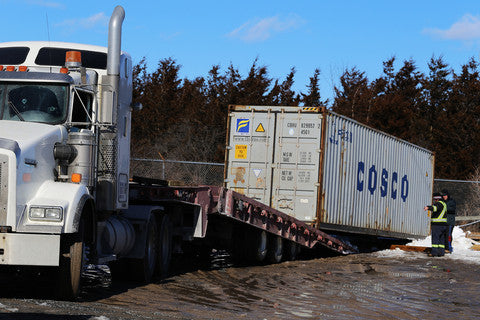Container placement and unloading with tilt truck
