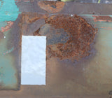 Repair patch on rusty shipping container