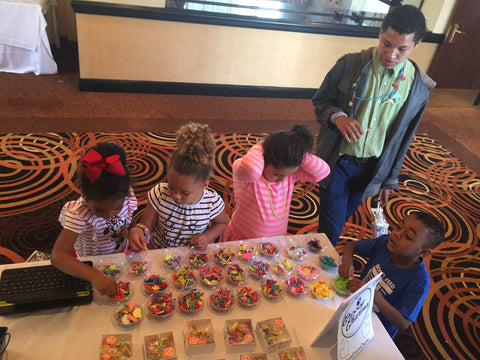 Children Playing With GroovyCharms At Pre Oscar Party