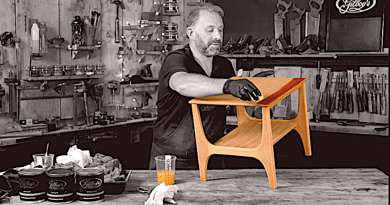 applying hardwax oil to a Nathan teak table