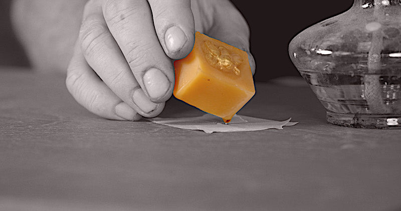 using a beeswax repair block to disguise a scratch in furniture