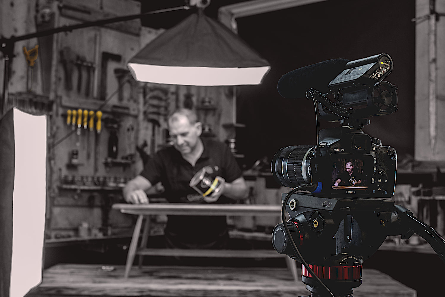 simon gilboy in front of the camera demonstrating how to use beeswax wood polish