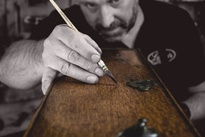 retouching the grain on an antique drawer