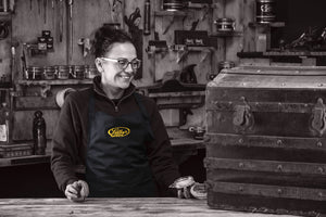 Jo wearing the restorer's bib apron in the workshop