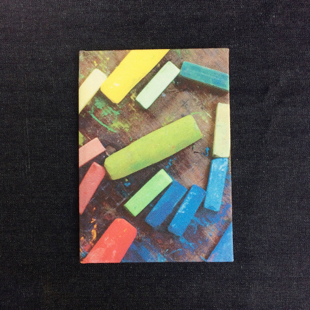 Colorful chalks Black fabric covered sketchbook