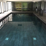 Stunning black tiled pool
