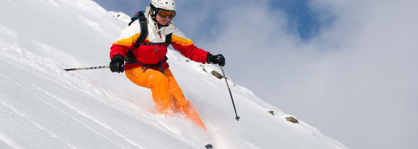 downhill ski woman Colorado snowboarding skiing