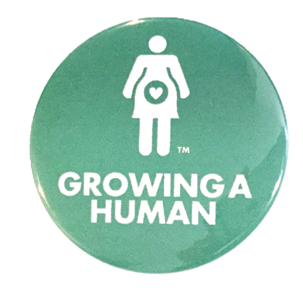 Growing a Human Graphic Pin - English