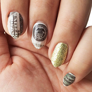 Image showing the final design with money nails and a glittery ring accent nail.