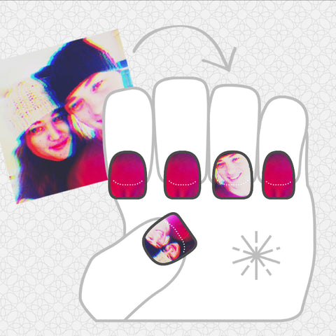 Image showing NailSnaps with faces as accent fingers and darker colored nails for the others.
