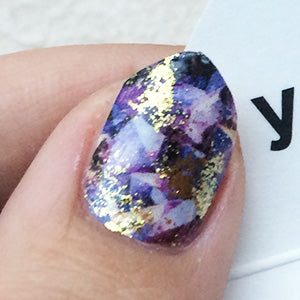 Image showing purple amethyst nails with gold accents.