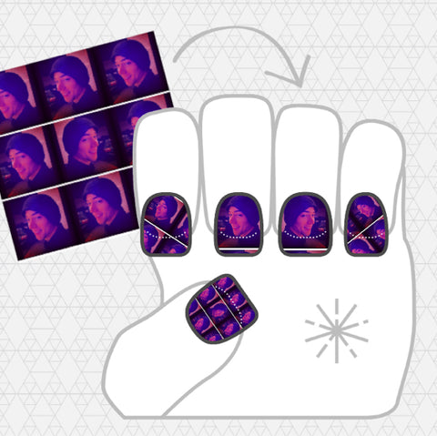 Image showing dark purple and pink NailSnaps of my boyfriend's face.