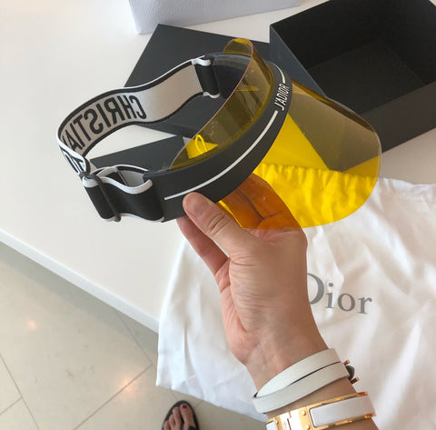 c80a8eb37c306 The iconic Christian Dior logo with a Fashion Accessory Visor has already  taken over the Globe. The Dior Visor is a Must have this Spring   Summer!