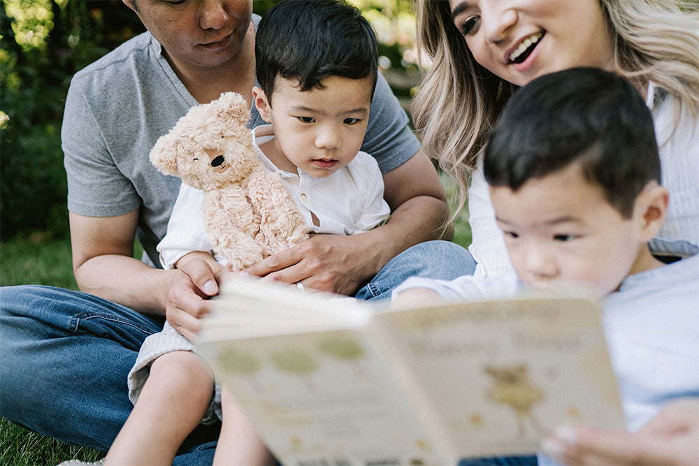 Family reading Honey Bear to their two twin boys