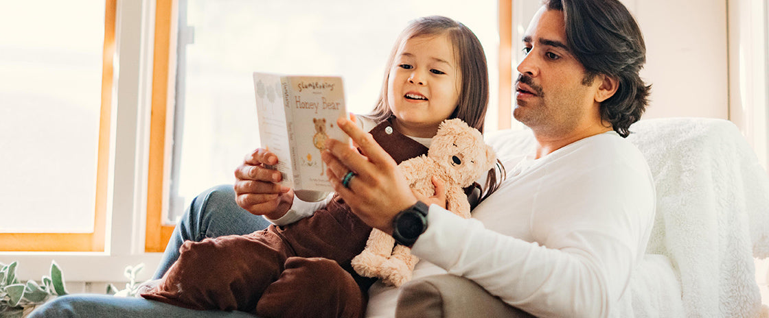 father and daughter reading honey bear book