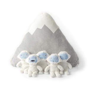 All 5 mini Yetis sitting in front of the Zip-up mountain pilow