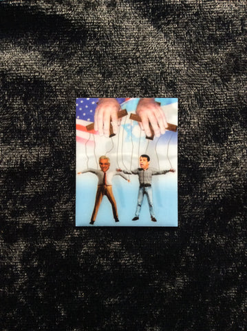 Pin Rectangular featuring 2 men on puppet strings