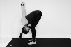 Work- Pogamat Blog- Yoga for Back Pain-11-standing forward fold pose