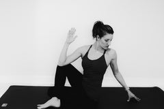 Work- Pogamat Blog- Yoga for Back Pain- seated spinal twist pose