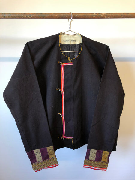 Embroidered Jacket with purple mountains, people and rice paddies hung on rail