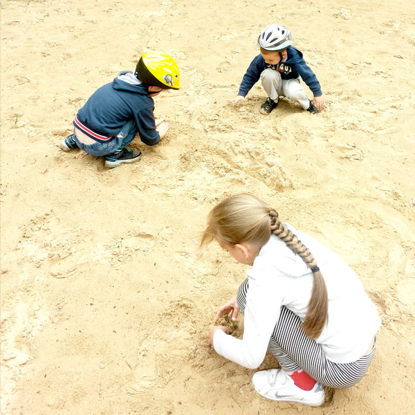 Children playing in sand and building kingdoms