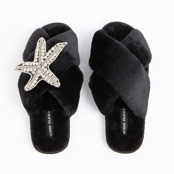 Bobbi Parka fluffy faux fur slippers in black with a crystal starfish brooch