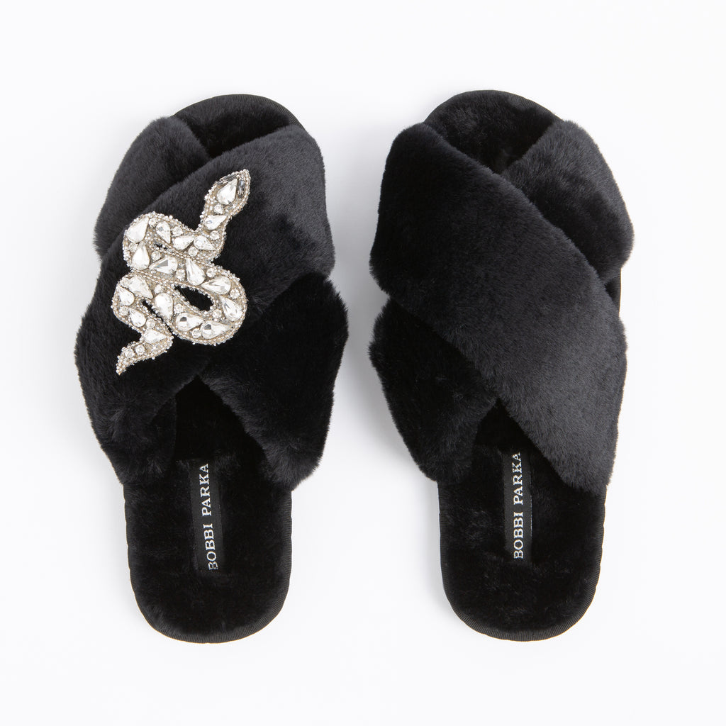 Bobbi Parka fluffy faux fur slippers in black with a crystal snake brooch