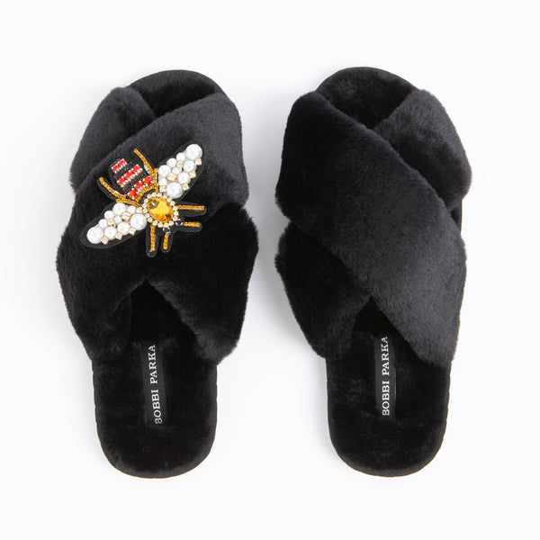 Bobbi Parka fluffy faux fur slippers in black with a crystal bee brooch