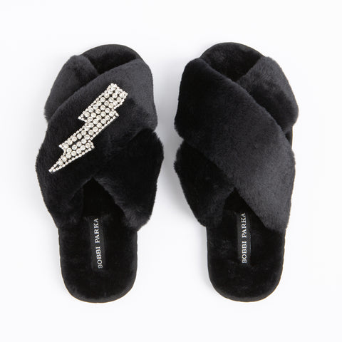Bobbi Parka fluffy faux fur slippers in black with a crystal lighnting brooch