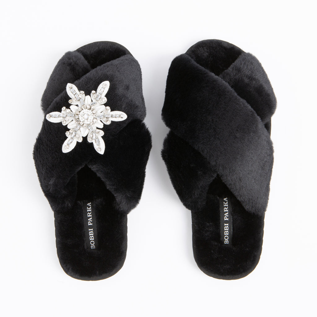 Bobbi Parka fluffy faux fur slippers in black with a crystal snowflake brooch