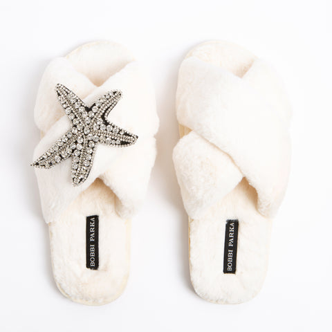 Bobbi Parka fluffy faux fur slippers in cream with a crystal starfish brooch
