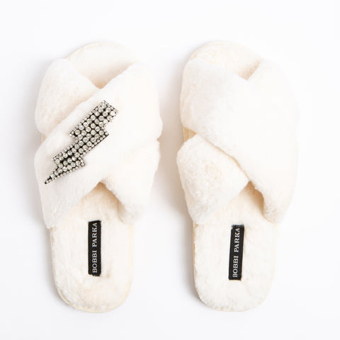 Bobbi Parka fluffy faux fur slippers in cream with a crystal lightning brooch