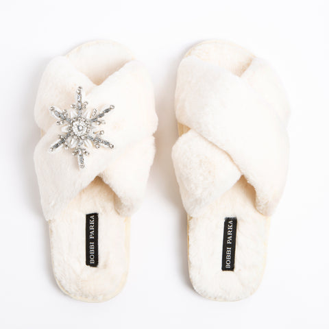 Bobbi Parka fluffy faux fur slippers in cream with a crystal snowflake brooch