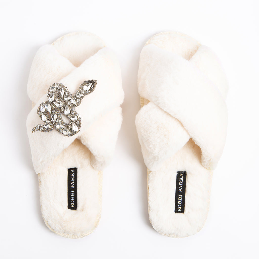 Bobbi Parka fluffy faux fur slippers in cream with a crystal snake brooch