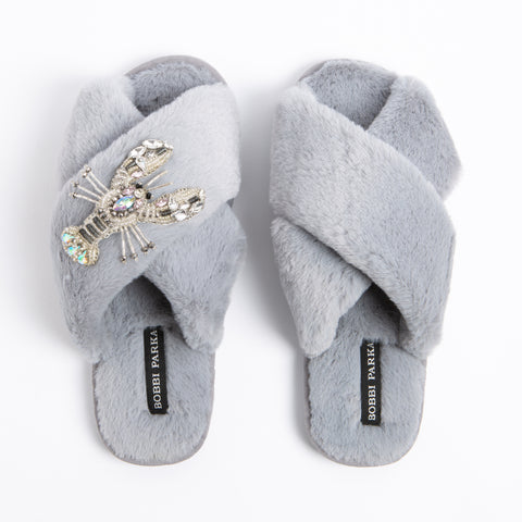 Bobbi Parka fluffy faux fur slippers in grey with a crystal lobster brooch
