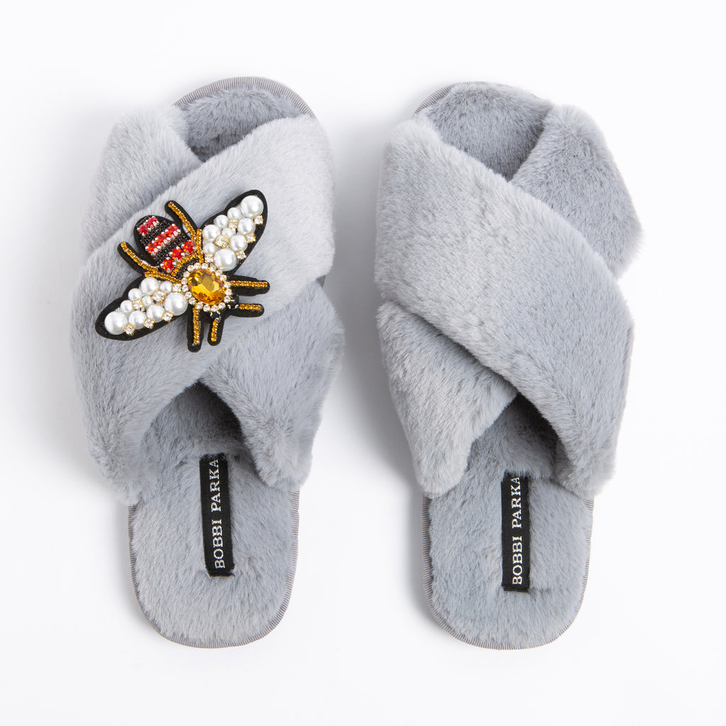 Bobbi Parka fluffy faux fur slippers in grey with a crystal bee brooch
