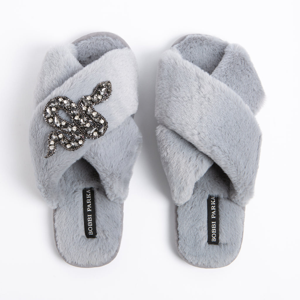 Bobbi Parka fluffy faux fur slippers in grey with a crystal snake brooch