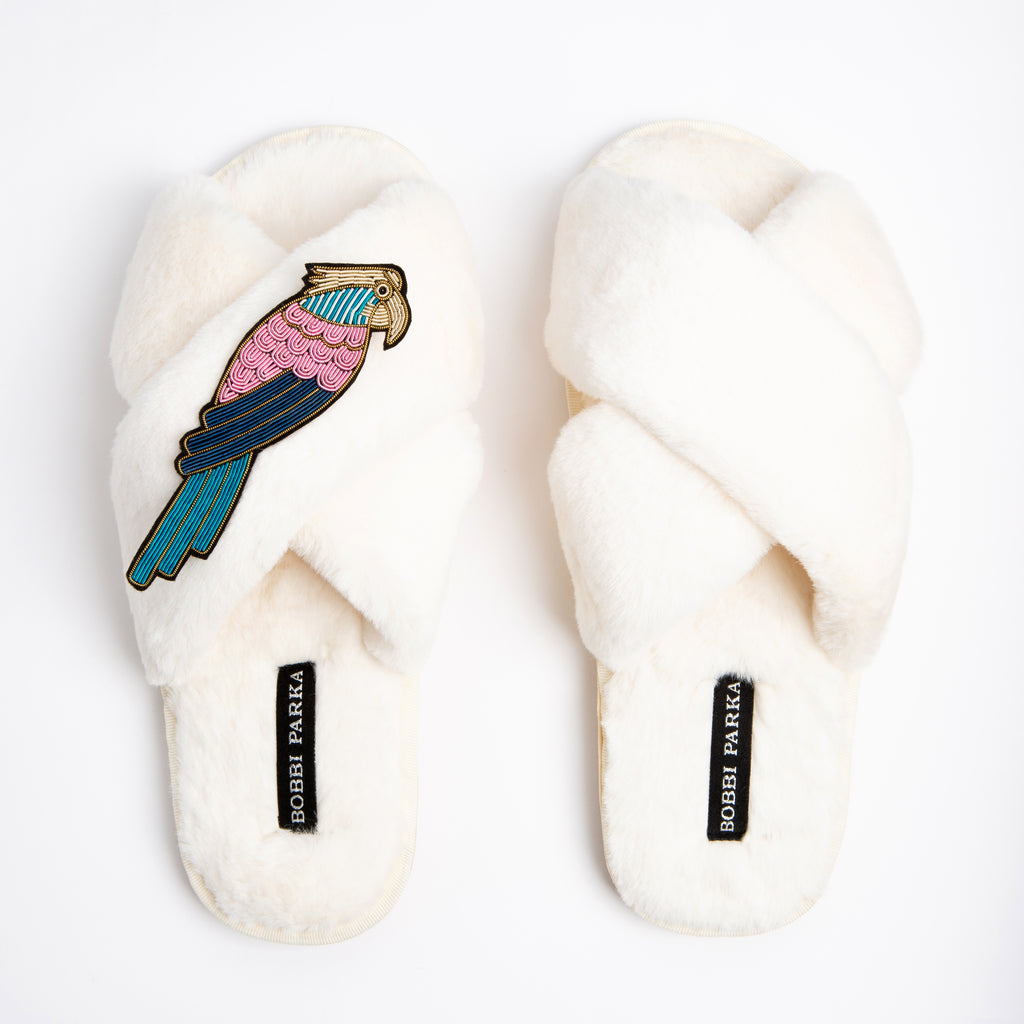 Bobbi Parka fluffy faux fur slippers with a crystal parrot brooch