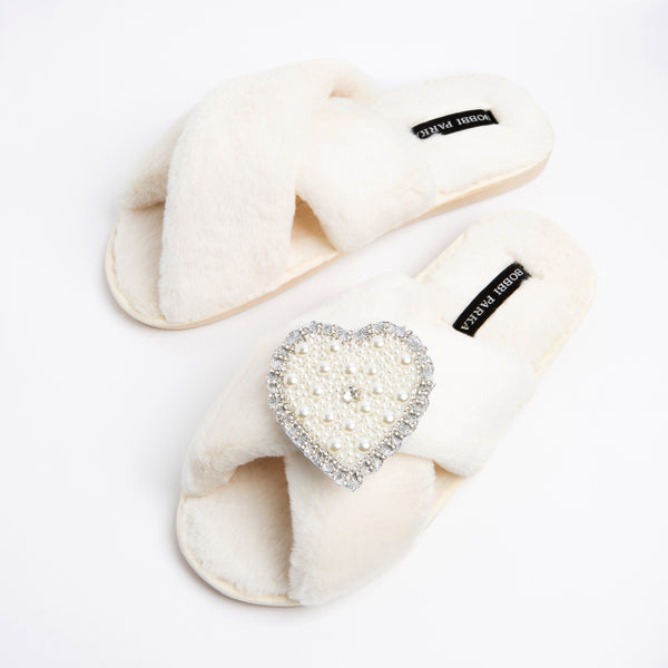 Bobbi Parka fluffy faux fur slippers in cream with a crystal love heart brooch