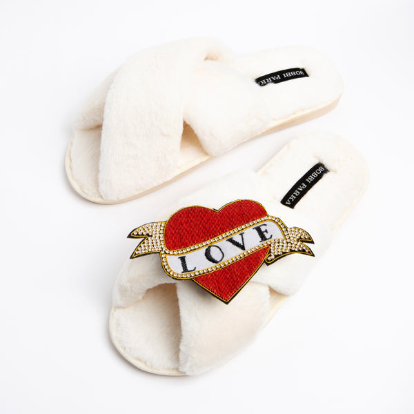 Bobbi Parka fluffy faux fur slippers in cream with a crystal love brooch