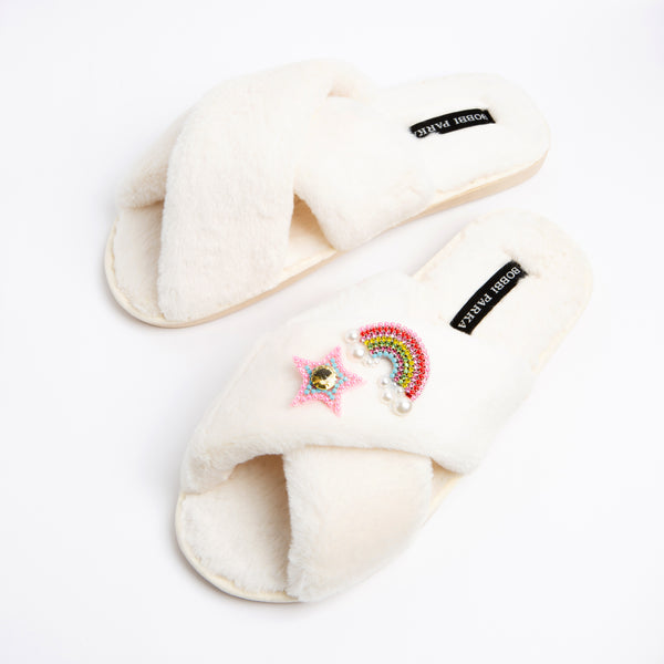 Bobbi Parka fluffy faux fur slippers in cream with a crystal rainbow star brooch