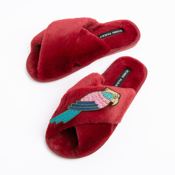 Bobbi Parka fluffy faux fur slippers in red with a crystal parrot brooch