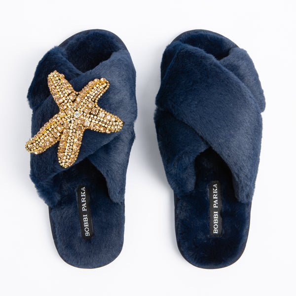Bobbi Parka fluffy faux fur slippers in navy with a crystal starfish brooch