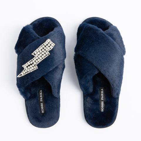 Bobbi Parka fluffy faux fur slippers in navy with a crystal lightning brooch