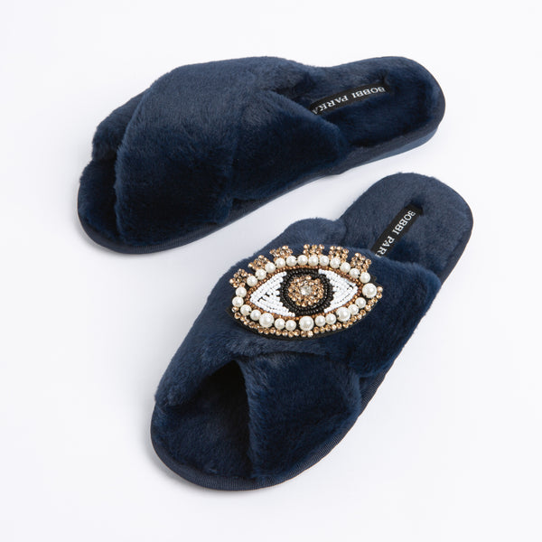 Bobbi Parka fluffy faux fur slippers in navy with a crystal eye brooch