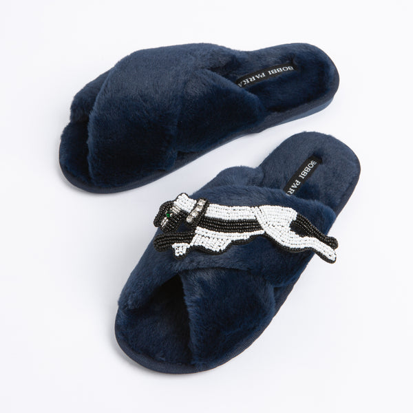 Bobbi Parka fluffy faux fur slippers with a panther brooch