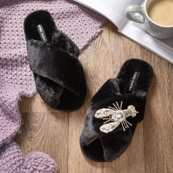 Bobbi Parka fluffy faux fur slippers in black with a crystal lobster brooch